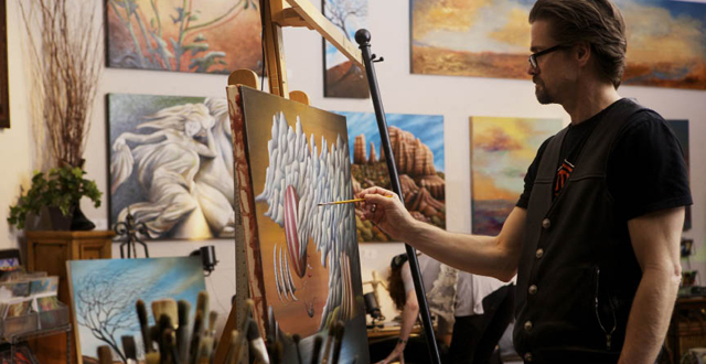 Doug Winters paints in his artist studio, Skypony, which he shares with wife Kiki Curry Winters, pictured below.
