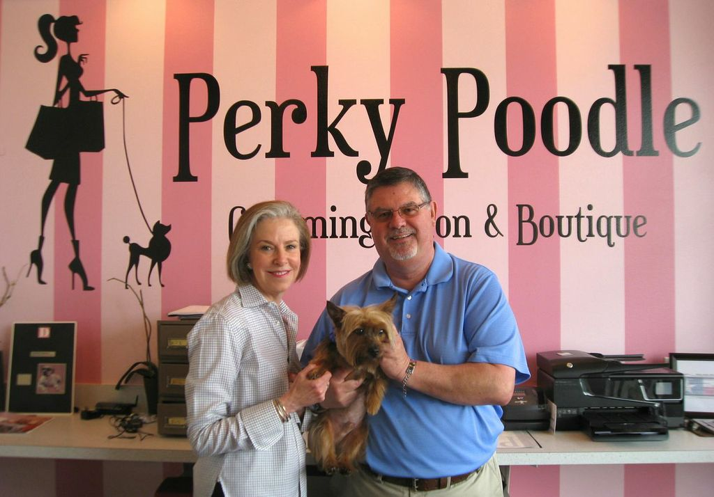 Preston Hollow neighbor Eliza Solender and Perky Poodle owner Michael Pugh with his dog, Tully