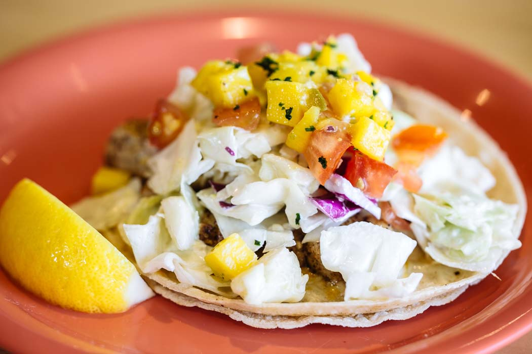 The restaurant is famous for its fish tacos topped with a heaping mound of coconut milk-based coleslaw and mango salsa. Photo by Kathy Tran