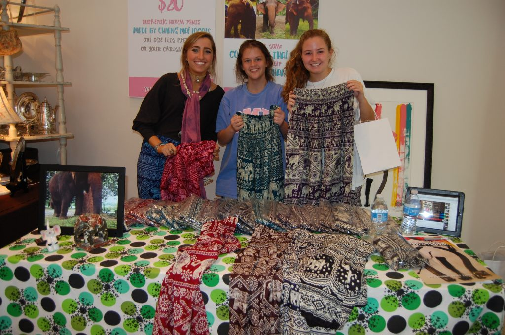 Maya Elia (far left) and two of her friends holding Elepants.