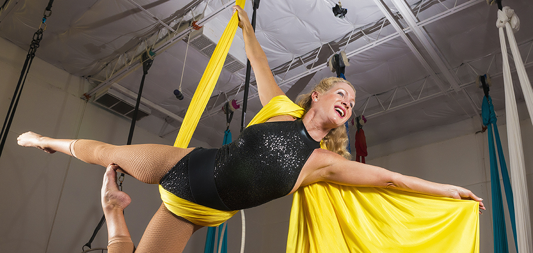 DALLAS, TX 06/30/2016 Aerialist Stephanie Stewart works the silk at Lone Star Circus in Dallas, TX on June 30, 2016. Stewart, 56, said she took to aerial silk performance after dreading the repetition of the gym. Credit: Danny Fulgencio