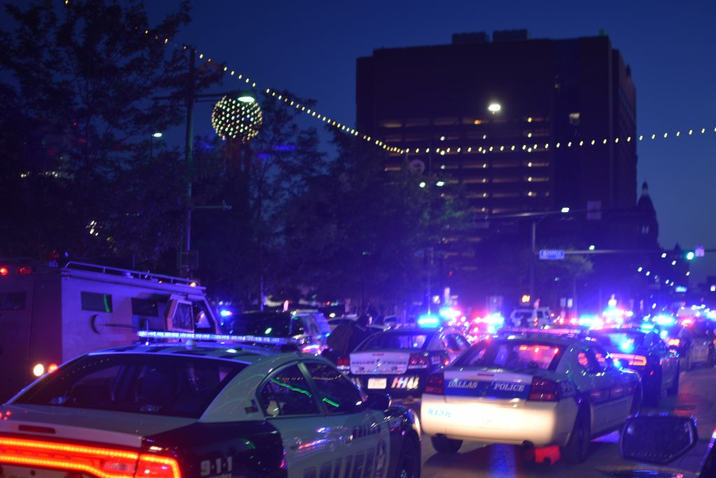 Police crowded Belo Garden Park after two snipers opened fire. (Photo by Matt Botts)