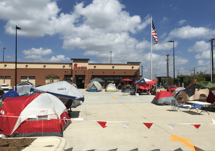 Campers hope for a year's worth of free chicken at the new Chick-fil-A near LBJ and Midway. (Photo by Lauren Law)